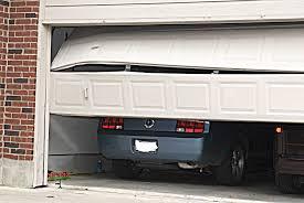a dent in the garage door