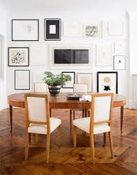 dining room with collected art in various frames all for color diningroom tables