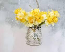 faux daffodils in gl vase