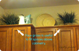 Over Cabinet Decor Decorating The Top Of Kitchen Cabinets Kitchen Cabinet Decorating