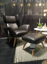 ... Man Cave Decor Idea With Modern Black Letaher Man Cave Chair With  Ottoman On Striped Fabric Rugs And Black Laminate Vinyl Floor Masculine  Furniture for ...