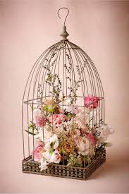 Or one like this, birdcage Centerpiece, I would do one of my smaller  birdcages with moss, a pillar candle and a small vase with pink and white  tulips in it.