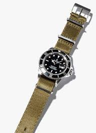 editor s choice crown buckle has made aftermarket leather and nato straps for several years but the supreme released just late last year is their take
