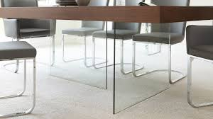 floating tempered glass and dark wood dining table