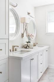 light gray double bath vanity with white marble convex mirrors