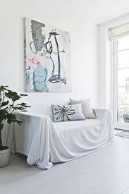 a bright little cozy corner with an old sofa covered a white sheet and pillows cover my furniture o47 cover