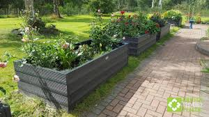 a row of british recycled plastic raised beds in scotland all made from the kits