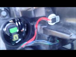 How to Change Chevy Impala HEADLIGHT BULB - YouTube
