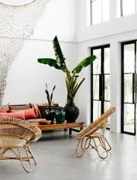 the living room has a loft like feel with seven metre high ceilings