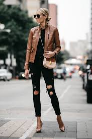 blonde woman wearing tan leather moto jacket black ripped skinny jeans outfit chloe drew handbag