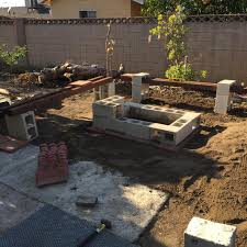 ritzy laying out cinderblock to see where things go diy backyard cinder block fire pit al