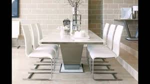 dining room simple white marble dining table for 6 white dining chairs above marble floor around brick marble wall design the cly and elegant marble