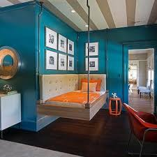 Peacock Blue Boys Bedroom with Bed Hanging From Ceiling