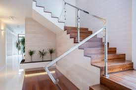 modern stairs with wood treads, steel hand rail, and glass siding
