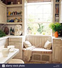 Window Seat Striped Cushion On Window Seat In Small Townhouse Kitchen With