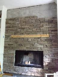 and now we have all the stone installed along with the barn wood mantel the last row of stone at the top required about 1 3 of the top to be cut off