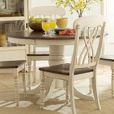 dining room small round pedestal table black faux leather tall backrest chairs white geometrical angular