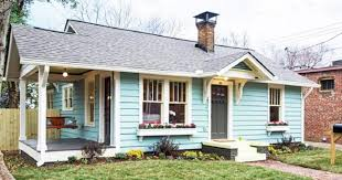 tiny house com. The Two Bedroom/ One Bathroom House Was Given A Bright Blue Coat Of Paint With Lime Green Accents And Flower Boxes Creating Crazy Curb Appeal. Tiny Com