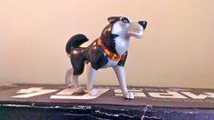this is a kfc toy of steele from the balto he is extremely rare and was made in 1995 by u s and amblin