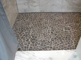 copious recycled grey pebble shower floor with white marble wall tile as decorate small space without door shower room designs