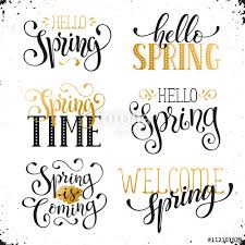 Hand written Spring time phrases in white and gold. Greeting card ...