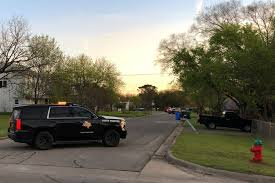 a texas department of public safety vehicle blocks a street into the neighborhood where the austin