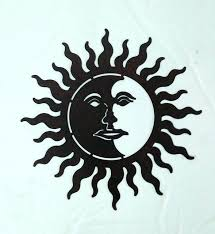 recycled metal moon and sun wall art