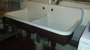 cast iron porcelain sink. This Old Tub And Sink With Cast Iron Porcelain