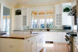 white country kitchen designs. Fine Designs The Georgian Or Palladian Windows Are Reflected In The Kitchenu0027s Cabinetry  Allowing Interesting Decorative Crockery On White Country Kitchen Designs H