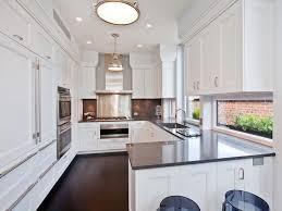 park avenue amazing kitchen with creamy white shaker cabinets grey quartz countertops grey quartz backsplash polished nickel