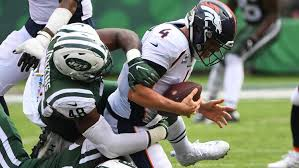 new york jets defensive end leonard williams and jets linebacker jordan jenkins sack denver broncos quarterback