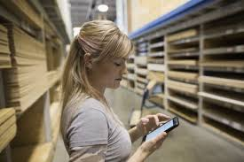 lowes contractors list. Perfect Contractors Woman With Cell Phone Shopping For Plywood In Home Improvement Store And Lowes Contractors List