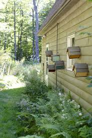 Birdhouses Christine Chitnis Gardenista. A great way to hang several bird  houses.