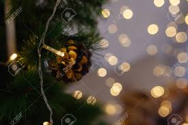 Close Up Of Pine Cone In Lights Garlands Of Light Bulbs With