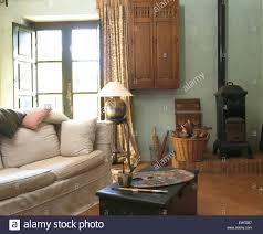 Wood Stove Living Room Design Small Wood Burning Stove And White Sofa In Spanish Country Living
