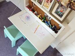 fold down children s table with storage inside and a chalkboard on the outside