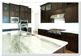 black cabinets with white granite dark countertops brown kitchen coun