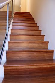 vinyl wood plank flooring on stairs with glass railings and stainless steel handrail ideas