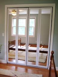 admirable four panel mirrored closet doors with white frames as inspiring bult in wardrobe for space saving bedroom ideas