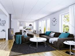 exquisite interior home decorating ideas with dark gray fabric sofa and blue cushion also white round blue dark trendy living room
