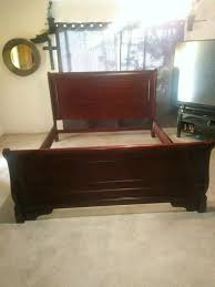 Cal King sleigh bed frame. Solid wood.