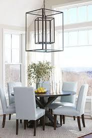 light blue dining room chairs round dining table large windows pendant lighting rachel reider