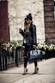 fashion blogger mia mia mine wearing a givenchy bag and black biker jacket from h m