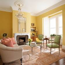 furniture living room wall: if we keep those yellow living room walls bathed in light from the bay window buttery yellow walls keep the large space from becoming too formal while