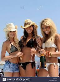 Girl with glasses poses in bikini