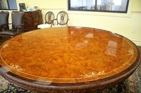 full size of luxurious 72 inch round walnut and pearl inlaid dining table shown under bright