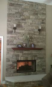 fireplace done in echo ridge country ledgestone by b cultured stone with wood mantel and custom masonry fireplace doors yelp