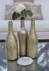 Nice for a chic Wedding ! DIY Sparkly Gold Wine Bottles- These are pretty!  Perfect for wedding decor