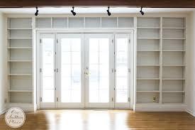 built in bookshelves ideas for adding bookshelves around a door onsuttonplace com