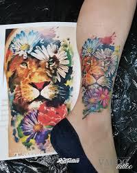 фото татуировки лев в стиле акварель татуировки на щиколотке